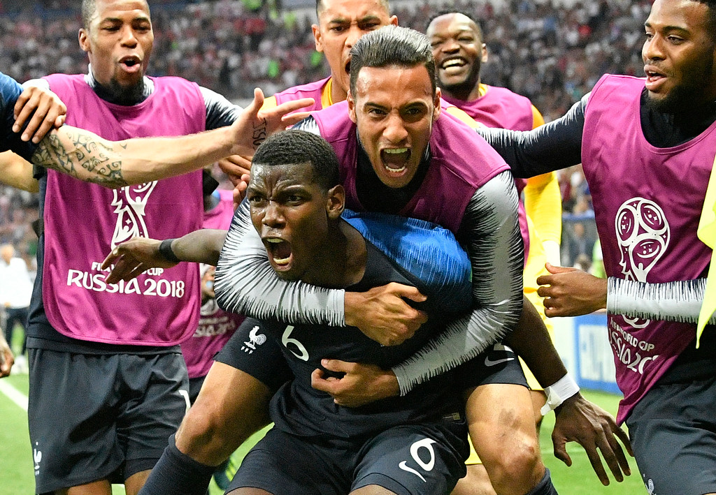 . France\'s Paul Pogba celebrates after scoring his side\'s third goal during the final match between France and Croatia at the 2018 soccer World Cup in the Luzhniki Stadium in Moscow, Russia, Sunday, July 15, 2018. (AP Photo/Martin Meissner)