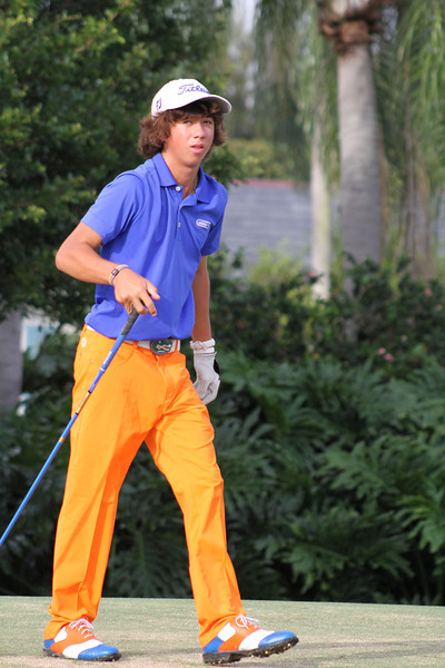 Kristian Caparros, Miami Lakes, Fla., walks off the 12th tee after putting his drive down the middle of the fairway in the final round.