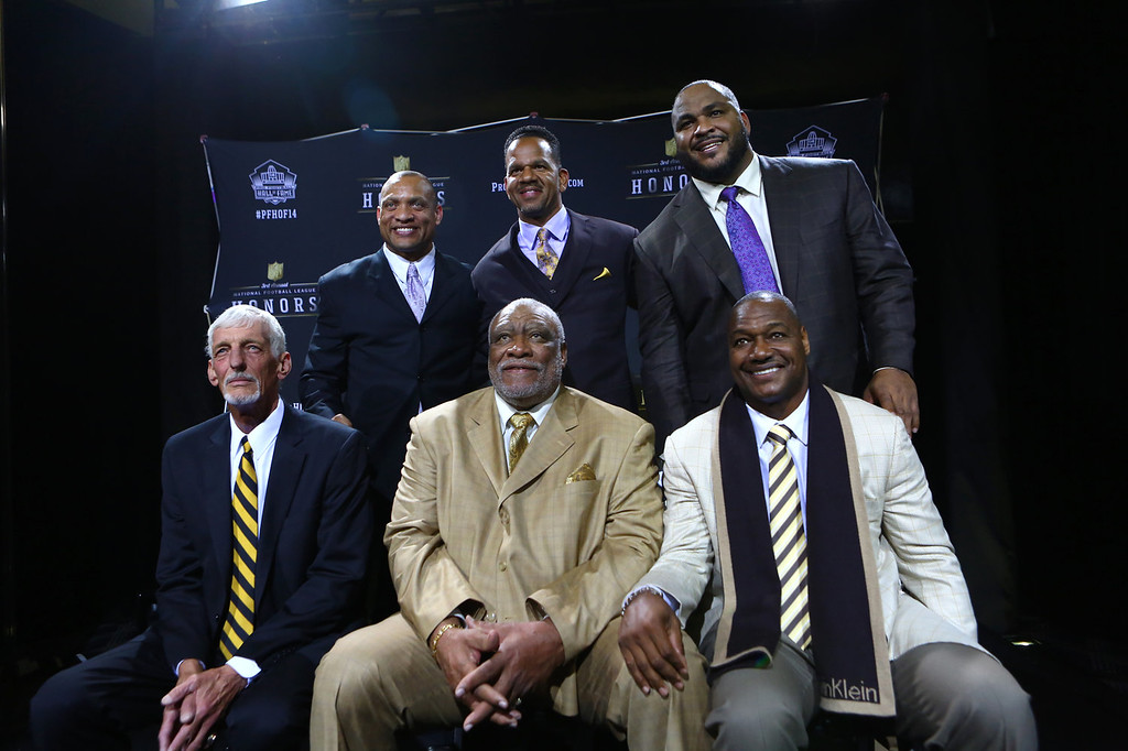 . Clockwise from top left, defensive back Aeneas Williams, wide receiver Andre Reed, offensive tackle Walter Jones, linebacker Derrick Brooks , defensive lineman Claude Humphrey and punter Ray Guy pose for a photo at the NFL Honors show Saturday, Feb. 1, 2014 at Radio City Music Hall in New York. (AP Photo/seattlepi.com, Joshua Trujillo)