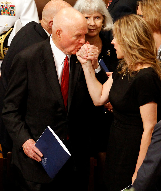 . Astronaut, and former Ohio Sen. John Glenn kisses singer Diana Krall\'s hand at the Washington National Cathedral in Washington, Thursday, Sept. 13, 2012, following a national memorial service for the first man to walk on the moon, Neil Armstrong. (AP Photo/Ann Heisenfelt)