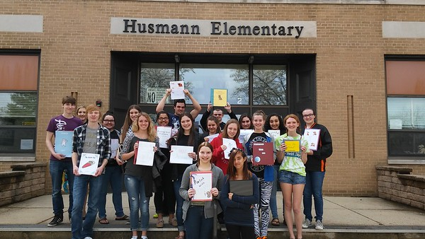 Senior Creative Writing Class Reads to Husmann Elementary School Students