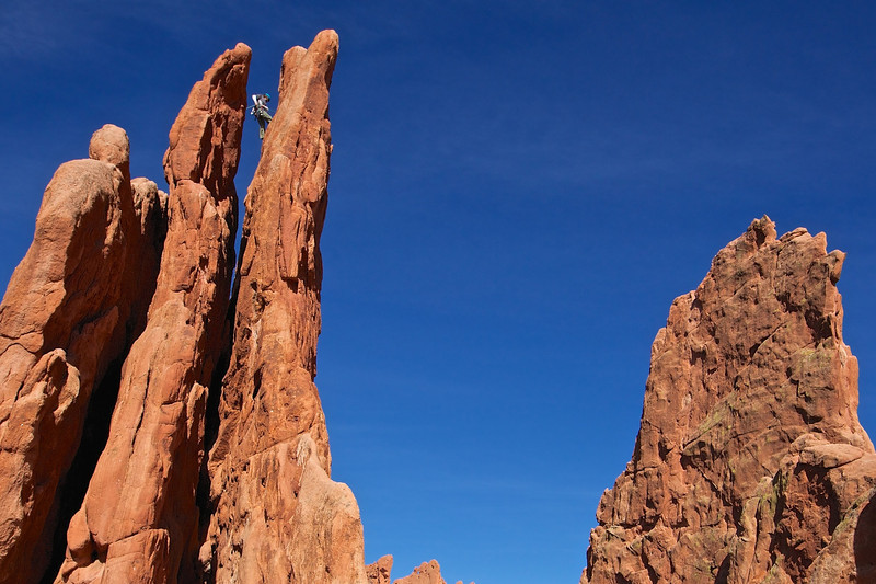 At the Garden of the Gods park. Rock climber near top of middle peak.