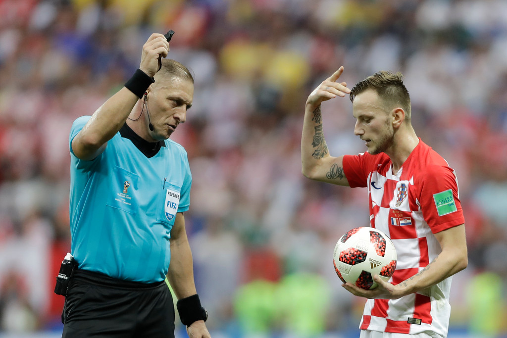 . Referee Nestor Pitana from Argentina admonishes Croatia\'s Ivan Rakitic during the final match between France and Croatia at the 2018 soccer World Cup in the Luzhniki Stadium in Moscow, Russia, Sunday, July 15, 2018. (AP Photo/Natacha Pisarenko)