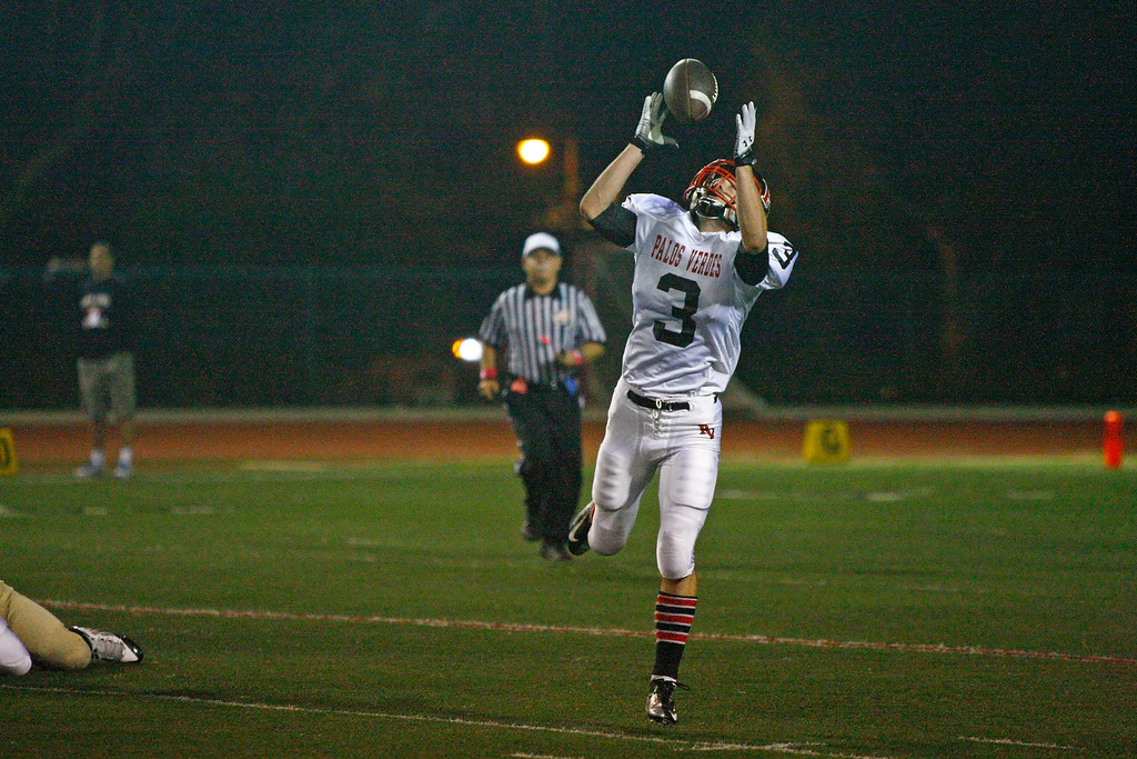 . Running back Tyler Moore #3 of Palos Verdes handles the high pitch from Quarterback Daniel DiRocco (not pictured) against the defense of Mira Costa in a Bay League matchup at Mira Costa High School on Friday, October 18, 2013 in Manhattan Beach, Calif.  (Michael Yanow / For the Daily Breeze)