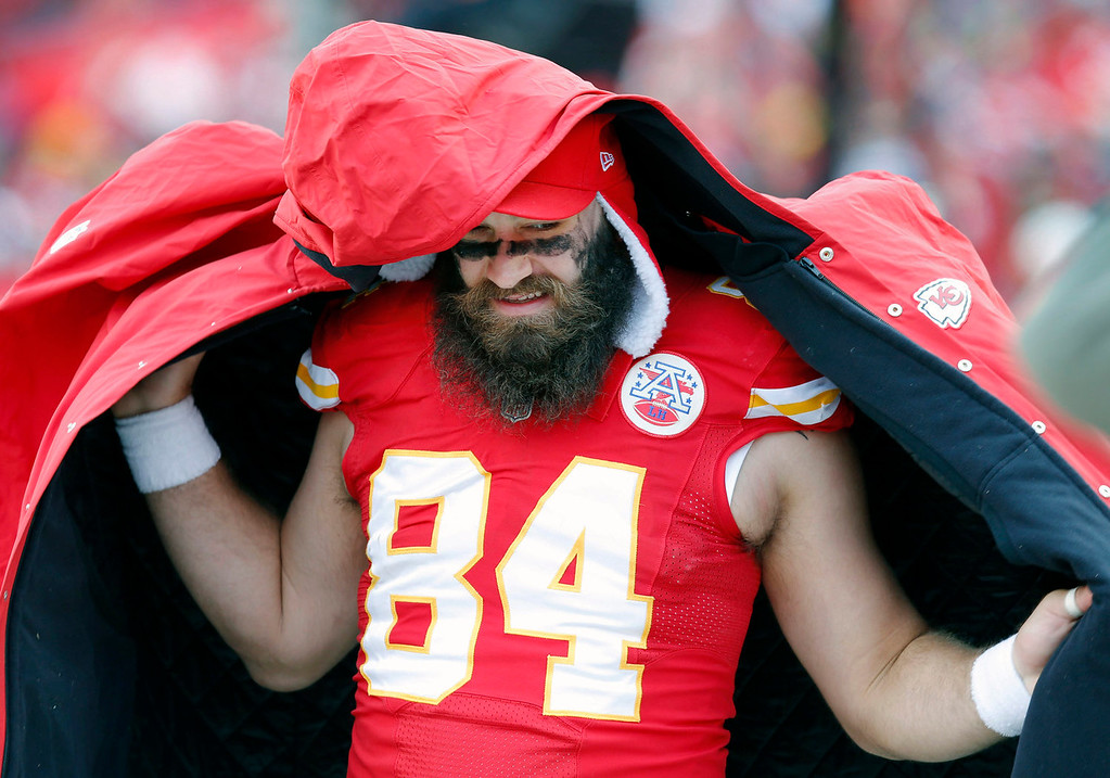 . Kansas City Chiefs tight end Sean McGrath (84) puts on a coat during the first half of an NFL football game against the San Diego Chargers in Kansas City, Mo., Sunday, Nov. 24, 2013. (AP Photo/Ed Zurga)