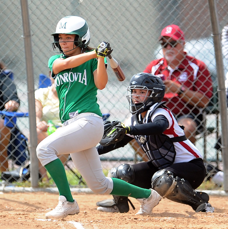 . Monrovia\'s Hunter Alvarez watches her RBI single in the first inning of the Northview Tournament championship softball game against Covina at Northview High School on Thursday, April 4, 2013 in Covina, Calif.  Monrovia won 6-0. 