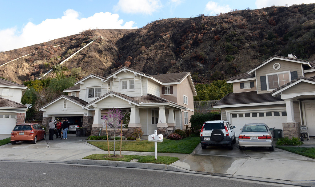. Residents on Ridge View Drive n Azusa are facing a mandatory evacuation in case the mud from the hills slides down ion Thursday February 27, 2014. (Staff Photo by Keith Durflinger/San Gabriel Valley Tribune)