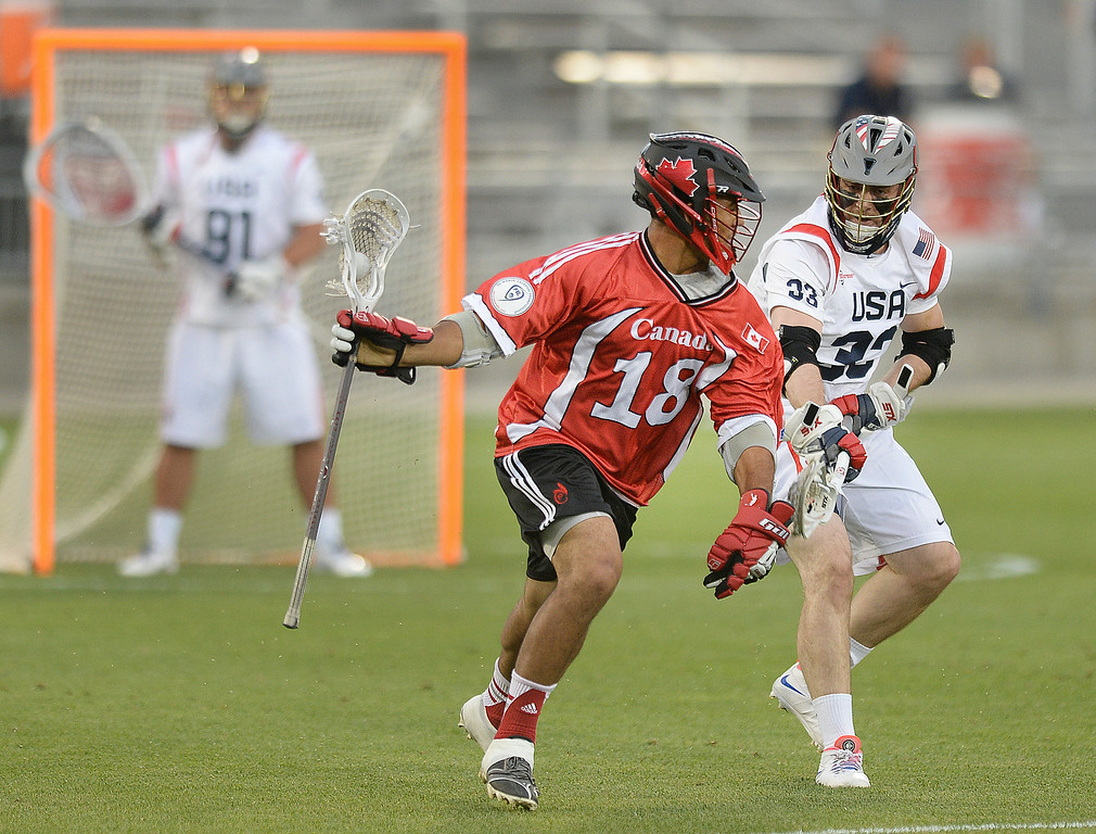 . US defender Michael Evans (33) tracked Canada midfielder Cam Flint (18) in the second quarter. The United States took on Canada in the opening game of the FIL World Lacrosse Championships Thursday night, July 10, 2014.   Photo by Karl Gehring/The Denver Post