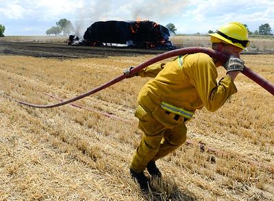 Semi destroyed by fire in stubble field