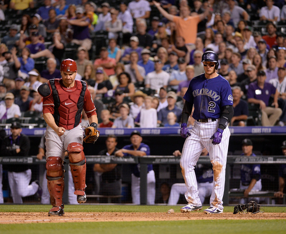 . Colorado Rockies shortstop Troy Tulowitzki (2) looks dejected after getting forced at home plate by Arizona Diamondbacks catcher Miguel Montero (26) in the seventh inning June 4, 2014 at Coors Field. (Photo by John Leyba/The Denver Post)