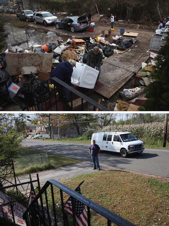 . NEW YORK, NY - NOVEMBER 01: (top) Members of the Hague family try to salvage a washing machine from their flood-damaged home after Hurricane Sandy on November 1, 2012 in the Ocean Breeze area in the Staten Island borough of New York City.  NEW YORK, NY - OCTOBER 17:  (bottom)  Neighbor Frank Moszczynski watches over the Hague family home, still uninhabited almost a year after Hurricane Sandy October 17, 2013 in the Ocean Breeze area in the Staten Island borough of New York City. Hurricane Sandy made landfall on October 29, 2012 near Brigantine, New Jersey and affected 24 states from Florida to Maine and cost the country an estimated $65 billion.  (Photos by John Moore/Getty Images)