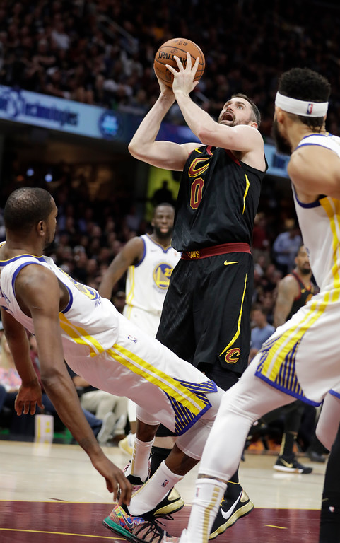. Cleveland Cavaliers\' Kevin Love shoots against Golden State Warriors\' Kevin Durant during the second half of Game 4 of basketball\'s NBA Finals, Friday, June 8, 2018, in Cleveland. (AP Photo/Tony Dejak)