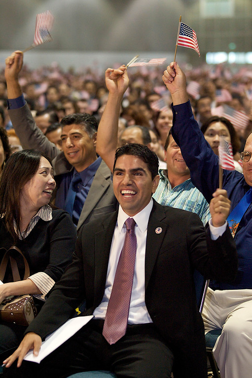 ". In this May 22, 2008 file photo, Eddie ""Piolin\"" Sotelo, host of Univision Radio\'s nationally syndicated morning show, expresses his joy after taking the citizenship oath during naturalization ceremonies at the Los Angeles Convention Center. \""Piolin\"" is the voice of the most popular Spanish-language radio show in the U.S.  (AP Photo/Damian Dovarganes, file)"
