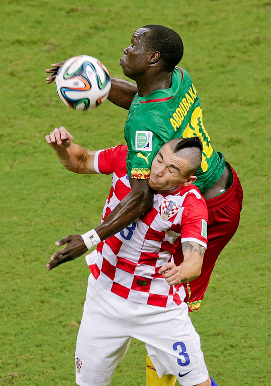 . Cameroon\'s Vincent Aboubakar, top, and Croatia\'s Danijel Pranjic go for a header during the group A World Cup soccer match between Cameroon and Croatia at the Arena da Amazonia in Manaus, Brazil, Wednesday, June 18, 2014.  (AP Photo/Fernando Llano)
