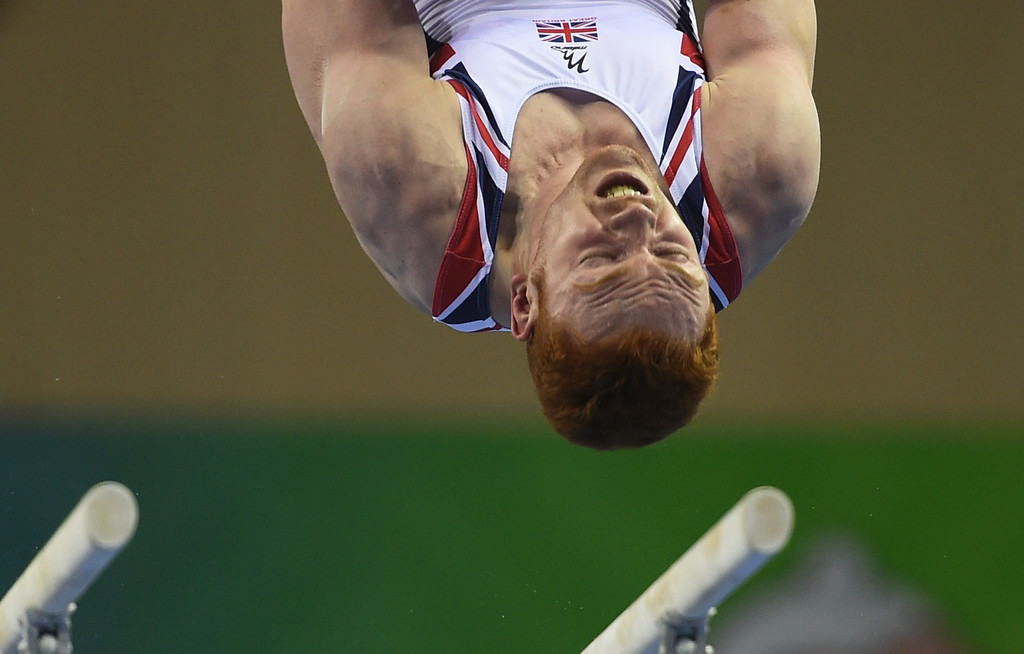 . Britain\'s Daniel Purvis performs on the parallel bars during the men\'s qualification at the Gymnastics World Championships in Nanning, in China\'s southern Guangxi province on October 3, 2014. GREG BAKER/AFP/Getty Images