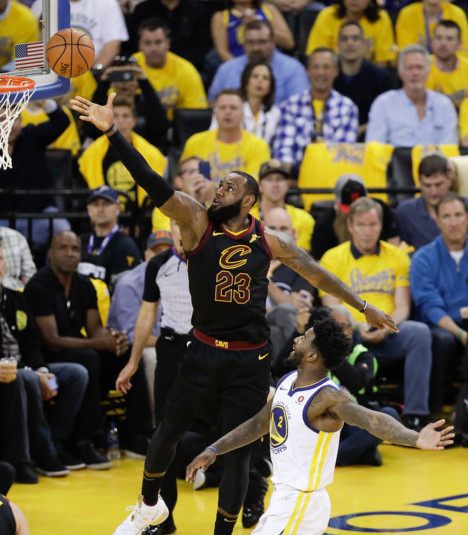 . Cleveland Cavaliers forward LeBron James (23) shoots over Golden State Warriors forward Jordan Bell (2) during the first half of Game 1 of basketball\'s NBA Finals in Oakland, Calif., Thursday, May 31, 2018. (AP Photo/Marcio Jose Sanchez)