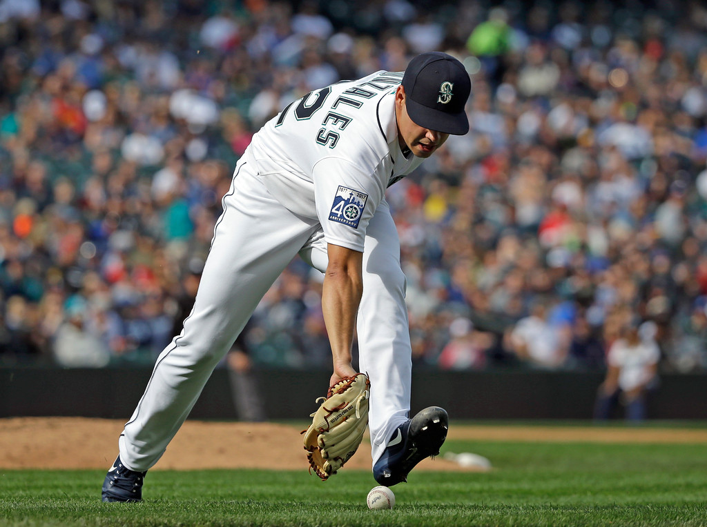 . Seattle Mariners relief pitcher Marco Gonzales chases an infield grounder against the Cleveland Indians in a baseball game Saturday, Sept. 23, 2017, in Seattle. (AP Photo/Elaine Thompson)