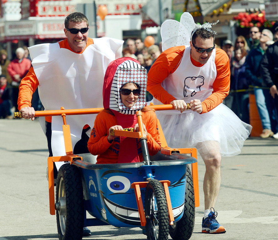 . Maribeth Joeright/MJoeright@News-Herald.com<p> The Chardon Smile Center bathtub race team, dressed their part as they raced in the popular Geauga County Maple Festival event, April 27, 2014. Shown is Jen Hanaus at the wheel, Bryce Tischer, left, and Dr. Brian Titus.