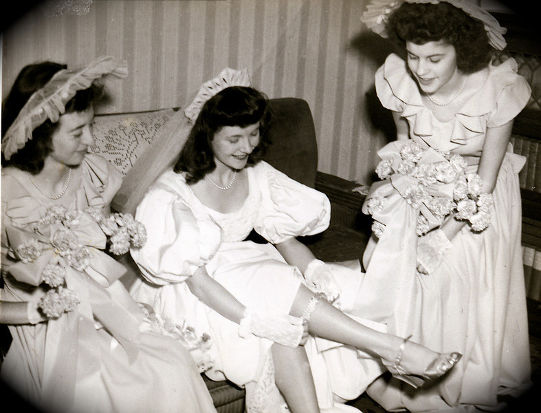 Putting on the garter with, L to R: Rosemary Rausch, Dodie, Jane Harwig