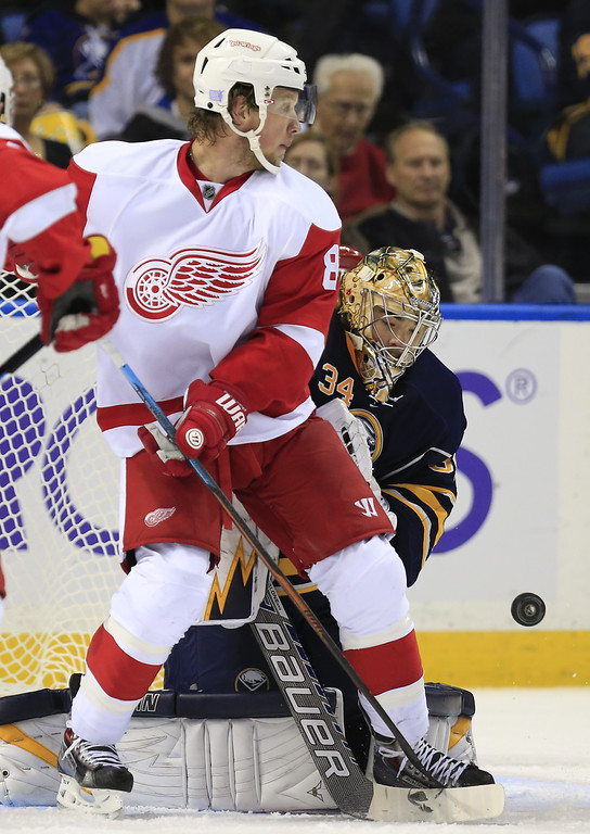 . Buffalo Sabres goaltender Michal Neuvirth (34) makes a save as he is screened by Detroit Red Wing player Justin Abdelkader (8) during an NHL hockey game, Sunday, Nov. 2, 2014, in Buffalo, N.Y. (AP Photo/The Buffalo News, Harry Scull Jr)