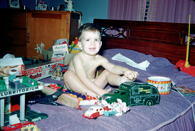 richard on bed with toys.jpg