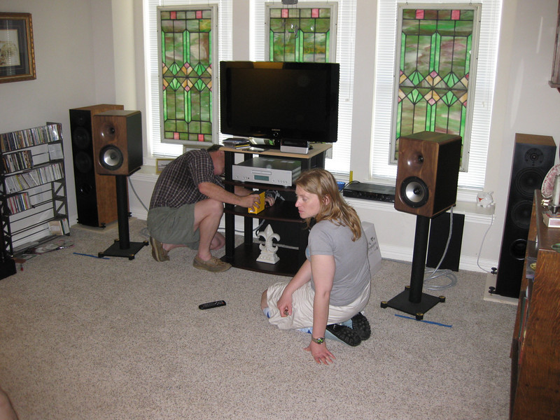 Sarah Cooke supervises my installation of her Virtue Two. I use lightweight Belden speaker cables with the Virtue amps because they don't pull the amp off the shelf like my carpet pythons do.