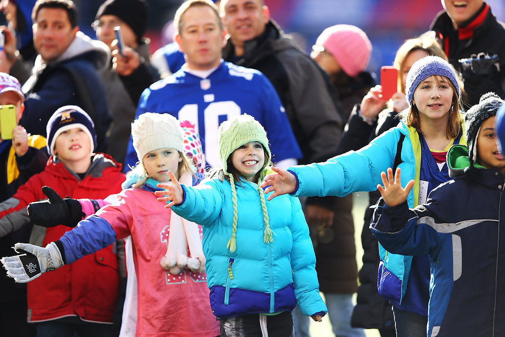 . Families of Sandy Hook Elementary School wait for the New York Giants before the game against the Philadelphia Eagles  their game against the at MetLife Stadium on December 30, 2012 in East Rutherford, New Jersey.  (Photo by Al Bello/Getty Images)