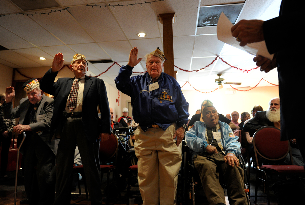 . After the veterans said they were more than ready to go, Brig. Gen. Sal Villano, right, chairman of the Forgotten Heroes Campaign, swears the men in for 20 more years of reserve service. Pearl Harbor veterans from left to right are George Richard, Dave Wilson, Jim Doyle, and Luz Valerio (sitting in wheelchair).The American Legion Post 1 in Denver hosts a Remember Pearl Harbor 71st Anniversary Program on Friday, Dec. 7, 2012, honoring the survivors, their wives, and the widows. Kathryn Scott Osler, The Denver Post