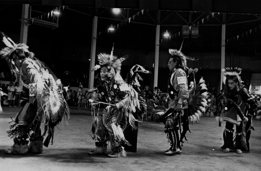 . Whooping it up at the Denver Western Stock show Arena Sioux Indians in colorful tribal dress are shown participating in the Sioux Indian Pow Wow Saturday at the National Western Stock Show Arena. 1980. John Prieto, The Denver Post