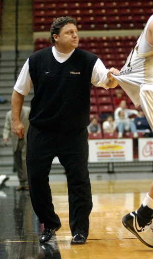 Description of . Oakland University men's basketball head coach Greg Kampe, left, grabs his player, Vova Severovas, to get his attention during a break in the action as they played Western Illinois during the second half, Saturday, March 3, 2007, at the UMAC in Tulsa, OK.  Oakland beat WIU, 74-57.  (The Oakland Press/Jose Juarez)