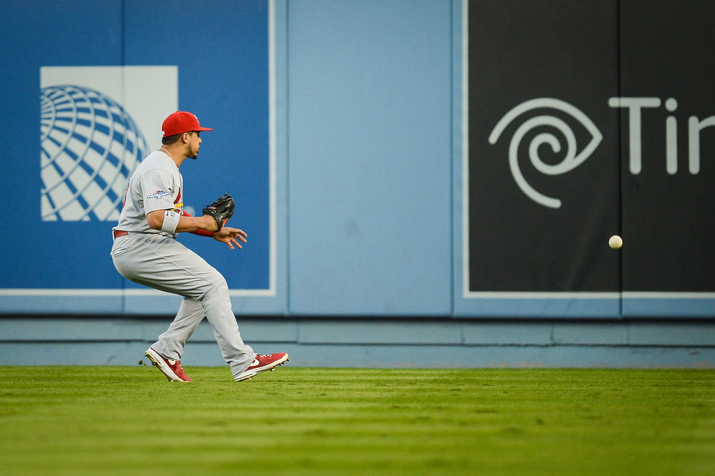 . Cardinals\' Matt Carpenter can\'t make the play on this hit from Dodgers\' Mark Ellis in game 3 of the NLCS Monday October 14, 2013 ( Photo by Hans Gutknecht/Los Angeles Daily News )