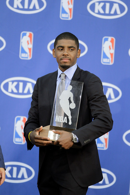 . Cleveland Cavaliers\' Kyrie Irving holds his NBA Rookie of the Year award at the basketball team\'s headquarters in Independence, Ohio Tuesday, May 15, 2012. (AP Photo/Mark Duncan)