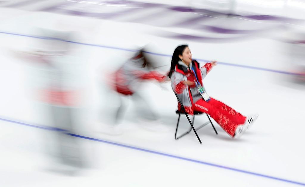 . A volunteer pushes another volunteer on a chair on the ice after the last speedskating race at the Gangneung Oval at the 2018 Winter Olympics in Gangneung, South Korea, Saturday, Feb. 24, 2018. (AP Photo/Vadim Ghirda)