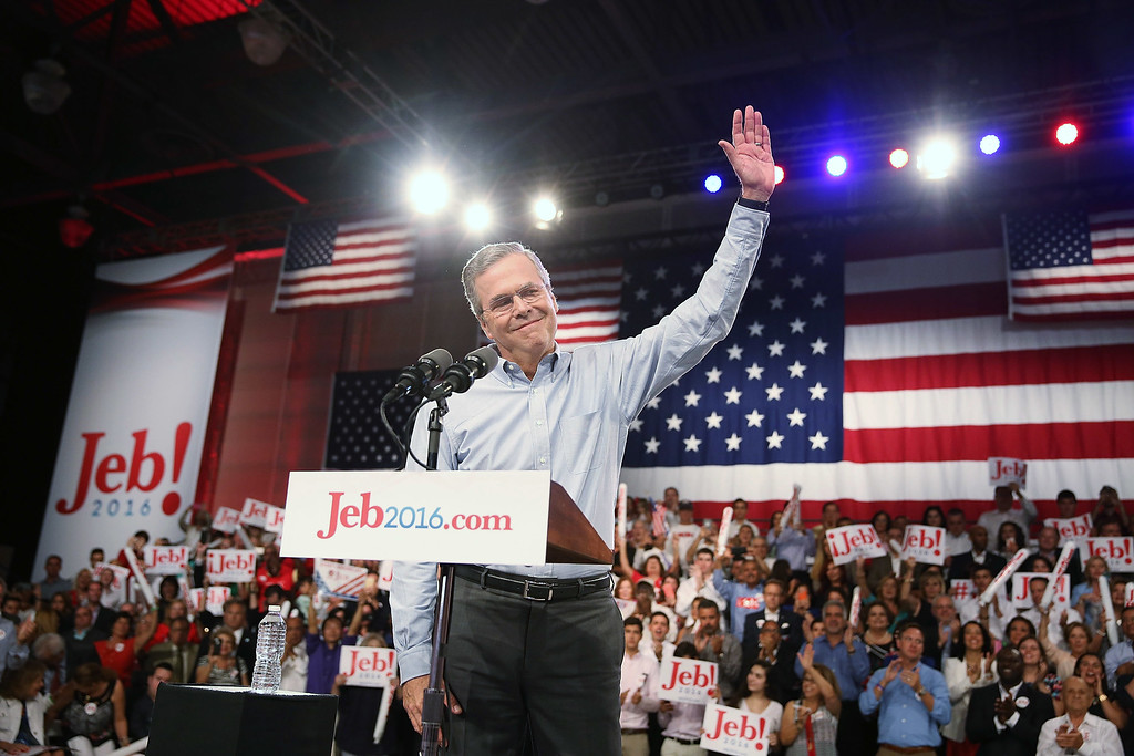 . Former Florida Governor Jeb Bush waves on stage as he announces his candidacy for the Republican presidential nomination during an event at Miami-Dade College - Kendall Campus on June 15 , 2015 in Miami, Florida. Bush joins a list of Republican candidates to announce their plans on running against the Democrats for the White House.  (Photo by Joe Raedle/Getty Images)