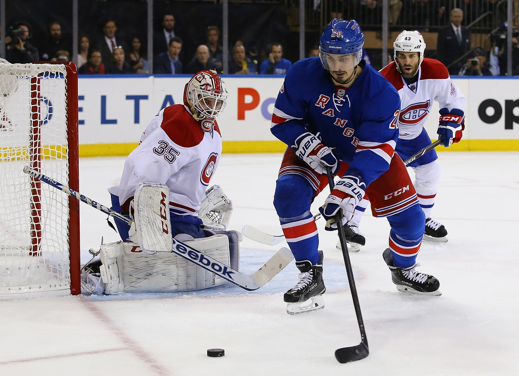 . Dustin Tokarski #35 of the Montreal Canadiens defends the net against Chris Kreider #20 of the New York Rangers in Game Three of the Eastern Conference Final during the 2014 NHL Stanley Cup Playoffs at Madison Square Garden on May 22, 2014 in New York City.  (Photo by Al Bello/Getty Images)