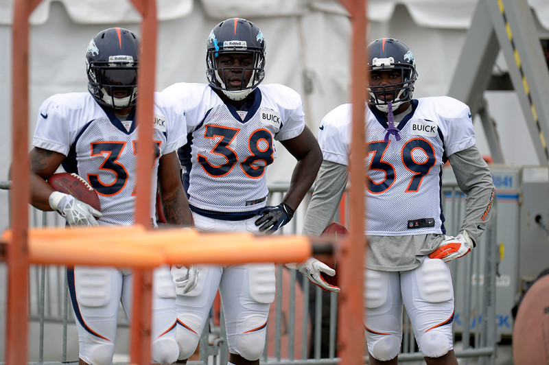 . Denver Broncos RB\'s Jeremiah Johnson (37) Montee Ball (38) C.J. Anderson (39) look on during drills during training camp July 29, 2013 at Dove Valley. (Photo By John Leyba/The Denver Post)