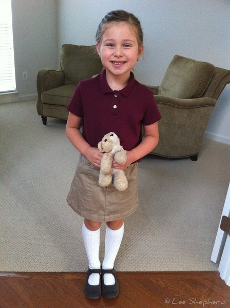 Madeline in her school uniform.  Ready for first grade!