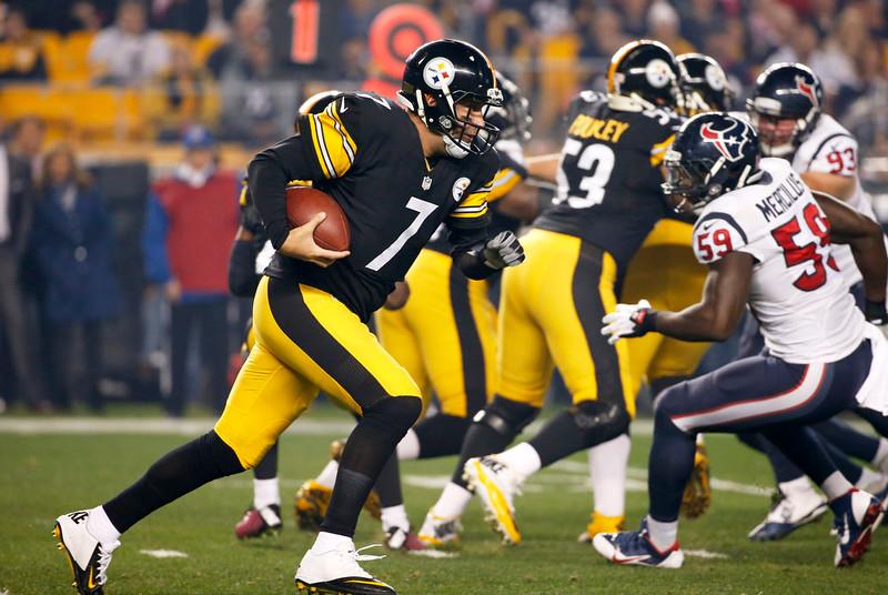. Pittsburgh Steelers quarterback Ben Roethlisberger (7) runs in the first quarter of the NFL football game towards Houston Texans outside linebacker Whitney Mercilus (59), Monday, Oct. 20, 2014, in Pittsburgh. (AP Photo/Gene J. Puskar)
