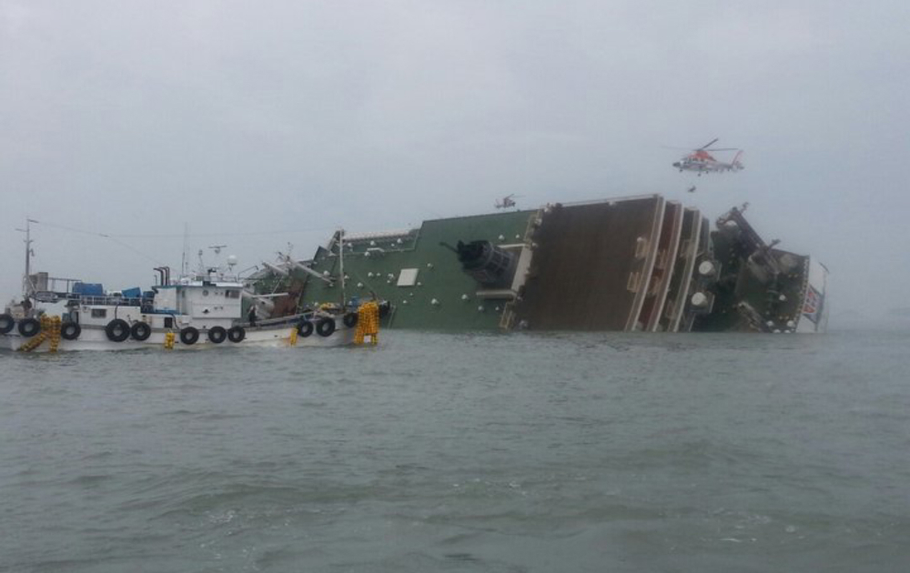 . South Korea rescue helicopter and fishing boats try to rescue passengers from a passenger ship in water off the southern coast in South Korea, Wednesday, April 16, 2014. The South Korean passenger ship carrying more than 470 people, including many high school students, is sinking off the country\'s southern coast Wednesday after sending a distress call, officials said. There are no immediate reports of causalities. (AP Photo/Yonhap)