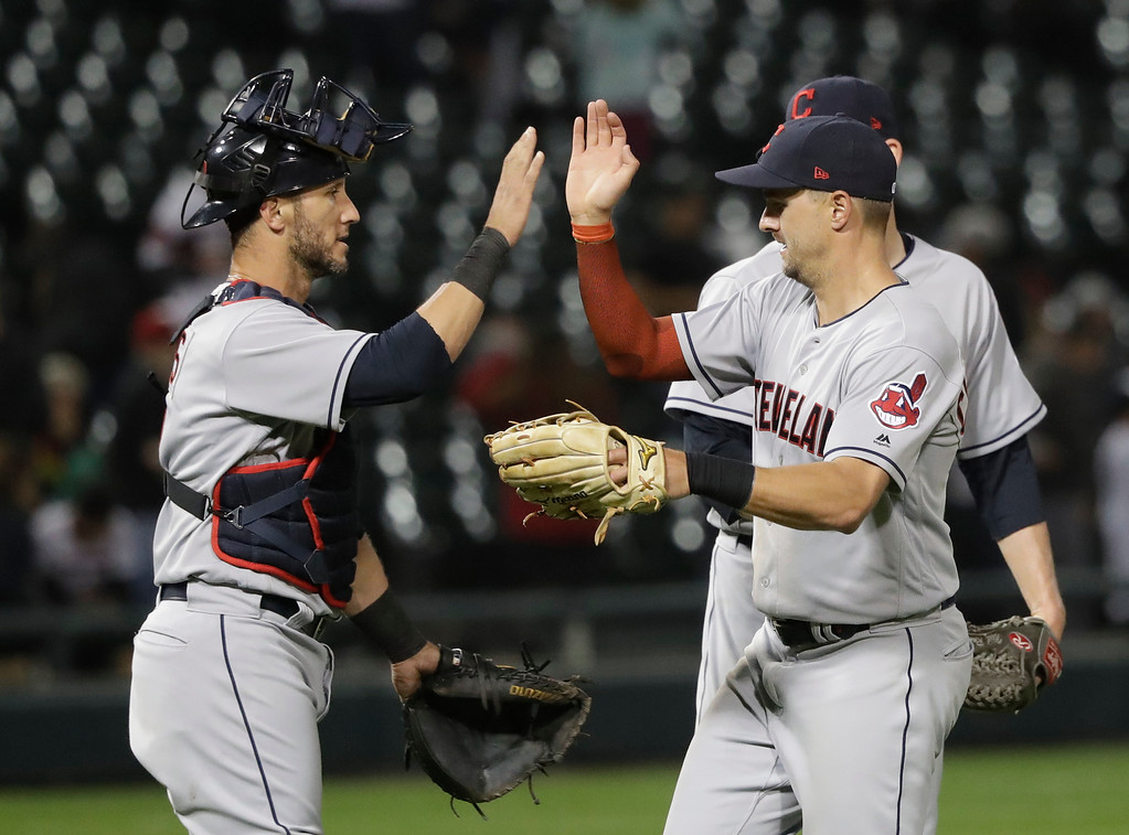 . Cleveland Indians catcher Yan Gomes, left, and Lonnie Chisenhall celebrate the team\'s 4-0 shutout of the Chicago White Sox after a baseball game Monday, June 11, 2018, in Chicago. (AP Photo/Charles Rex Arbogast)