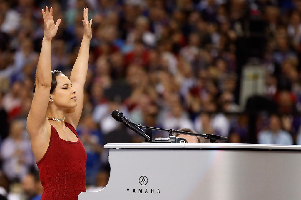 . Musician Alicia Keys performs the National Anthem prior to the start of Super Bowl XLVII between the Baltimore Ravens and the San Francisco 49ers at the Mercedes-Benz Superdome on February 3, 2013 in New Orleans, Louisiana.  (Photo by Chris Graythen/Getty Images)