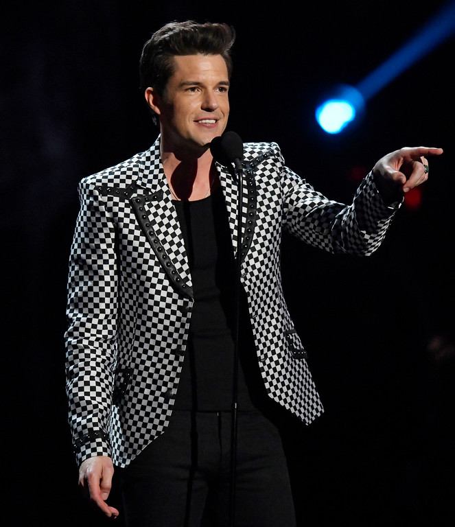 . Brandon Flowers, from the band The Killers, speaks during the Rock and Roll Hall of Fame induction ceremony, Saturday, April 14, 2018, in Cleveland. (AP Photo/David Richard)