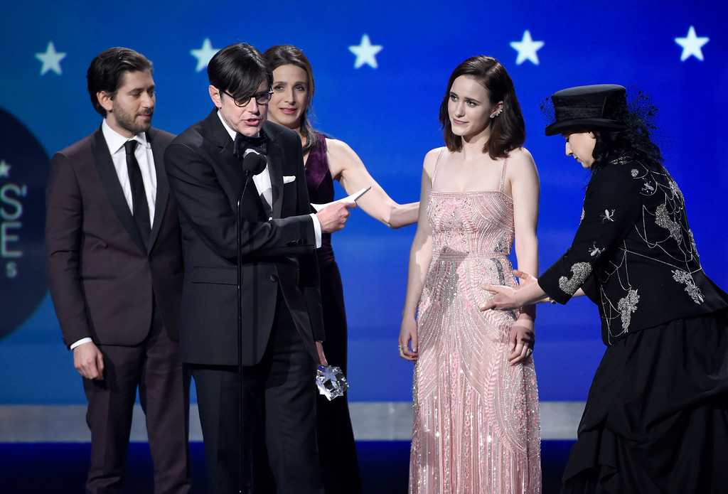 ". Michael Zegen, from left, Daniel Palladino, Marin Hinkle, Rachel Brosnahan, and Amy Sherman-Palladino accepts the award for best comedy series for ""The Marvelous Mrs. Maisel\"" at the 23rd annual Critics\' Choice Awards at the Barker Hangar on Thursday, Jan. 11, 2018, in Santa Monica, Calif. (Photo by Chris Pizzello/Invision/AP)"