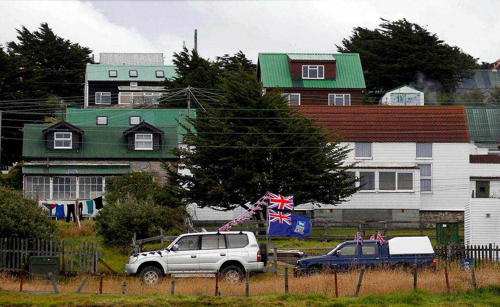. A vehicle decorated with a Falkland Islands flag and the Union Jack passes by in Stanley, March 11, 2013. Residents of the Falkland Islands started voting on Sunday and continue today in a sovereignty referendum that seeks to counter Argentina\'s increasingly assertive claim over the British-ruled territory.  REUTERS/Marcos Brindicci