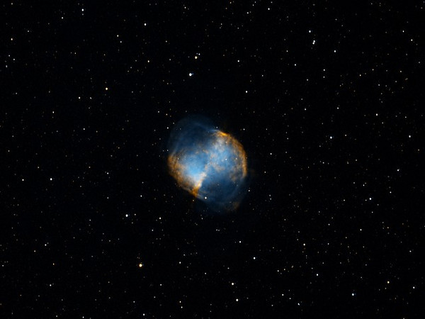 """Al, this picture of the Dumbell Nebula was taken a few days ago by my group colleague Maurice DeCastro.  Isn´t it wonderful? And I bet he did it from his backyard right in the middle of the city. He is currently using an Orion 190 mm Mak-Newt.  I think it´s an f-6 What I´m not sure of yet is if it is a full color shot or if it is a filtered and color assigned shot.  I say this because he is practicing a lot with the """"Hubble"""" method of assigning Halpha (red)- Olll and Olll filters blue and green I believe.."""