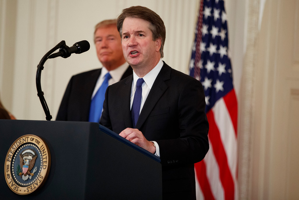 . President Donald Trump listens as Brett Kavanaugh, his Supreme Court nominee, speaks during an event in the East Room of the White House, Monday, July 9, 2018, in Washington. (AP Photo/Evan Vucci)
