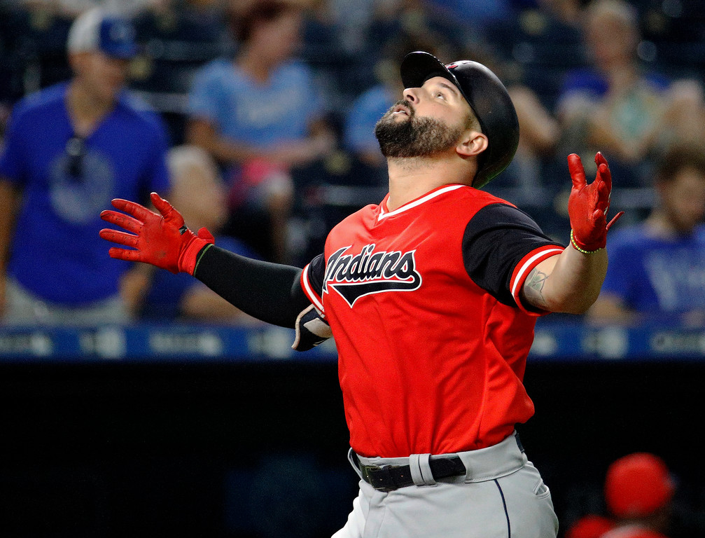 . Cleveland Indians\' Yonder Alonso crosses the plate after hitting a two-run home run during the eighth inning of a baseball game against the Kansas City Royals on Friday, Aug. 24, 2018, in Kansas City, Mo. (AP Photo/Charlie Riedel)