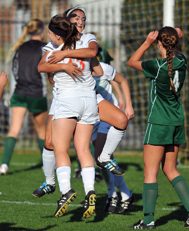 . LAKEWOOD - 02/14/2013  (Photo: Scott Varley, Los Angeles Newspaper Group)  St. Joseph hosts La Reina (Thousand Oaks) in a first-round Division 3 girls soccer playoff game. St. Joseph won 4-0. St. Joseph\'s Sarah Haley (back to camera) is hugged by Natalie De Leon after scoring in the 1st half.