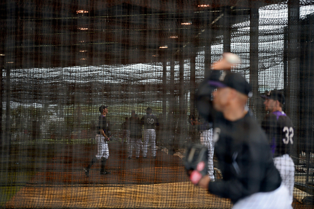 . SCOTTSDALE, AZ. - FEBRUARY 20: With the fields covered up, the Colorado Rockies had a short day hitting and throwing in the batting cages due to rain during Spring Training  February 20, 2013 in Scottsdale. (Photo By John Leyba/The Denver Post)