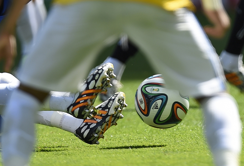 . Players fight for the Brazuca ball during the round of 16 football match between Brazil and Chile at The Mineirao Stadium in Belo Horizonte during the 2014 FIFA World Cup on June 28, 2014.  (FABRICE COFFRINI/AFP/Getty Images)